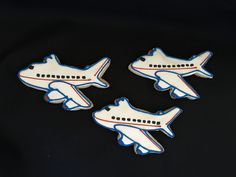 Airplane cookies. #cookiefavors #cookieart #airplanebirthday #kidsbirthday #seattlesweets #airplanecookies #travelcookies by sprinklesandsweetsseattle