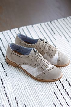 """Sport a timeless oxford style with this TOMS lace-up brogue. Featuring a fringe kiltie, this shoe will add a vintage appeal to your look. This women's brogue is available in desert taupe suede with a wool upper."