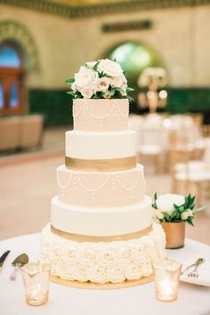 Five tier elegant rose topped wedding cake: http://www.stylemepretty.com/missouri-weddings/st-louis/2016/10/27/this-vintage-inspired-glam-fest-is-absolutely-perfect/ Photography: Erin Stubblefield & Portraiture - http://www.erinstubblefieldweddings.com/