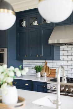 Navy Kitchen with small white subway tile and brass hardware all sources on., Blue Navy Kitchen with small white subway tile and brass hardware all sources on. Large Kitchen Cabinets, Kitchen Cabinet Colors, Upper Cabinets, Navy Blue Kitchen Cabinets, Navy Cabinets, Navy Blue Kitchens, Shaker Cabinets, Kitchen Colors, New Kitchen