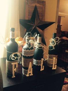 Fall wine bottles with black spray paint, burlap, and lace