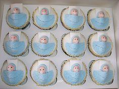 Baby Boy Cupcakes, via Flickr.  So cute!