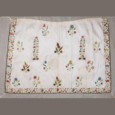 An 18th century embroidered apron and a tamboured panel  The circa 1740s apron of cream silk with a finely embroidered floral border, floral sprigs and uncut pocket slits in polychrome silk and metal threads, now mounted on stiff gauze (sd), 60 x 91cm; together with a late 18th century tamboured muslin panel depicting a foliate trellis design enclosing birds, animals and detailed floral studies, such as honeysuckle, pinks, lily-of-the-valley and daffodils, now mounted on purple shot silk
