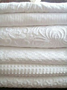 Fall Favorites & Familiars White coverlets: I'd love to add these to my linen closet. I'm a fanatic for using only cotton on the bed (there's nothing more comfortable for sleeping) AND for adding that one textured piece to give the bed that luxurious fee