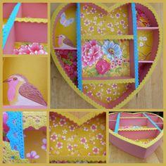 Hele mooie roze letterbak bekleed met geel PIP behang en schattige kantjes. Een blikvanger voor op de baby- of kinderkamer Afmetingen: 40 x 39 x 6 cm