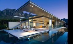 Patio with wraparound pool is the ultimate in outdoor style