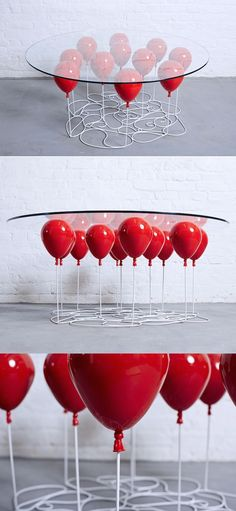 """Christopher Duffy of Duffy London created a playful """"Up"""" table that looks like it's floating on a bunch of balloons.  balloons 