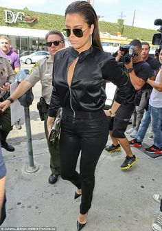 Ready for battle: Khloe Kardashian looks in no mood for talking as she films her reality show at Dash in West Hollywood