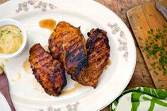 NYT Cooking: Sweet and Spicy Grilled Chicken Breasts - Brown sugar gives these grilled chicken breasts a glistening glaze and caramel-like sweetness, while mustard powder and cayenne add an earthy kick.