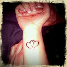 Tattoo - Intertwined Hearts (design) one of the hearts with the child's name