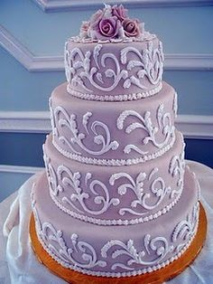 another cake 3 example - lavender buttercream background, white scroll-y things