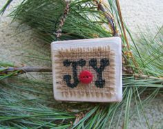 Small Rectangular Wooden Ornament With the Word Joy Painted in