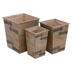 "Showcasing arrow details and a planked design, these wood planters create an eye-catching focal point in your foyer or living room.   Product: Small, medium and large planterConstruction Material: WoodColor: NaturalFeatures: Distinct arrow mark in dark brown colorDimensions: Small: 15"" H x 10"" W x 10"" DMedium: 17"" H x 13"" W x 13"" DLarge: 19"" H x 16"" W x 16"" D"