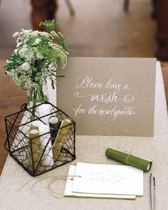 Sweet Scrolls - In lieu of a guest book, loved ones at this wedding were invited to leave their best wishes for the newlyweds on paper scrolls.
