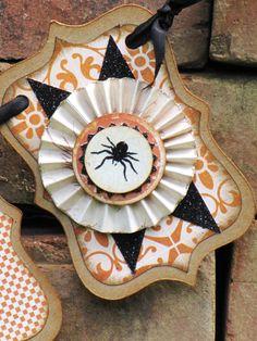 Vintage Halloween Inspired SPOOKY Banner Garland Victorian Paper Rosettes Spider. $22.00, via Etsy.
