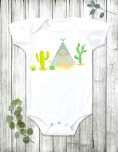 This boho baby Onesie® bodysuit has major desert vibes! The tribal teepee cactus design is handmade with love in Austin, TX. Also available in toddler t-shirts! Shop the outfit here: https://www.etsy.com/listing/260769293/baby-onesie-boho-baby-clothes-bohemian?ref=shop_home_active_20
