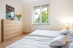 Cracoff | Chocimska 24 bright neutral bedroom with 2 joined small double beds for an extra large sleeping space