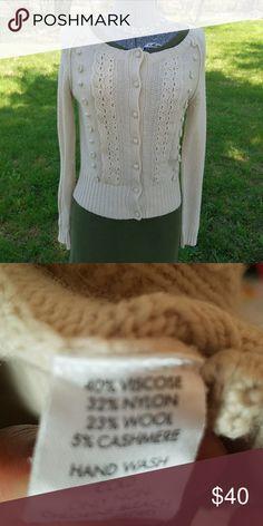 Calvin Klein wool cashmere blend cardigan Cream colored cardigan that is 40% viscose 33% nylon 22% wool and 5% cashmere. Calvin Klein Sweaters Cardigans