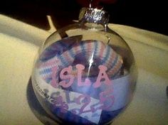 Babies Hospital Beanie & Hospital Bracelet inside a Clear Ornament with Name and Birthday Painted on the Outside.