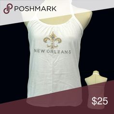 "New Orleans Saints Fluer Football T Shirt handmade New Orleans Saints Fluer Football T Shirt handmade from an upcycled cotton/poly t shirt.  Shirts are all handmade and may have side or back panels of cordinating colors   SIZE CHART Small fits 32""-34"" Medium fits 34""-36"" Large fits 36""-38"" XL fits 38""-40"" XXL fits 40""-42"" Tops Tank Tops"