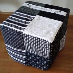 Handmade cover for hocker made with folkloric fabrics from Staphorst