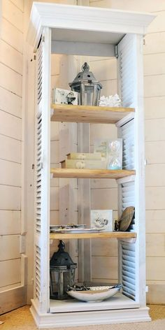 shelves made from shutters for towels in the bathroom.