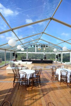 MARQUEE DANCEHALL. A dancehall with band stage was designed for this Kangaroo Valley wedding in a clear walled and roof marquee with parquetry dancefloor, lounges and french-style cafe with bar. #weddings #YourEventSolution