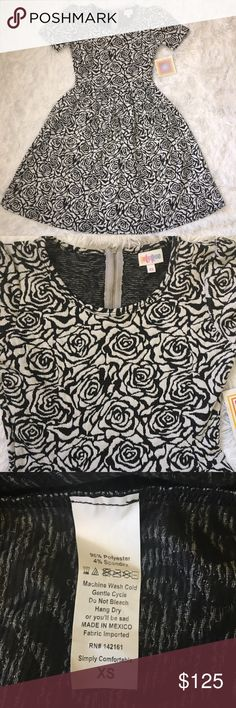Lularoe  black & white roses Amelia unicorn  YOUR time is VALUABLE ⏳, so I have searched high and low for this limited edition, hard to find, rare unicorn treasure ✨ This print symbolizes something you love ❤️  You WANT IT NOW, and here it is  Treat yo self   please, no rude comments LuLaRoe Dresses Midi