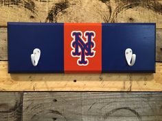 A personal favorite from my Etsy shop https://www.etsy.com/listing/456898102/new-york-mets-2-hook-hat-coat-rack
