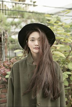 If I had that hair color, I would definitely wear an olive green coat. Stunning.