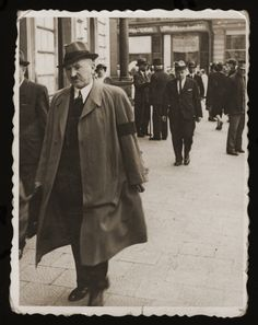 Dr. Isadore Gartenberg, an officer in the Austrian army, walks down a street in Drohobycz wearing a black armband.