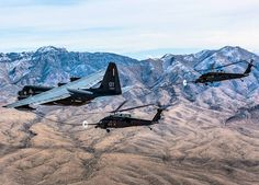 A pair of HH-60 Pave Hawk helicopters receive fuel from an HC-130J Combat King II cargo aircraft during a training mission over Nellis Air Force Base, Nevada.
