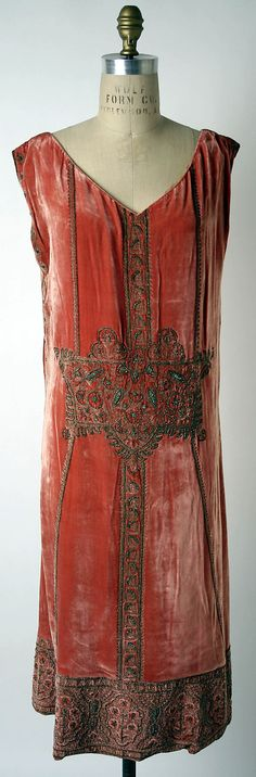 Designer: Jean Patou (French, 1887–1936)    Date: ca. 1924    Culture: French    Medium: silk, metallic thread, metal beads    Dimensions: Length: 43 1/4 in. (109.9 cm)  courtesy of the Metropolitan Museum of Art, NYC