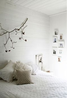 Sweet little bedroom. Love the comfy bedding and ornamental branch.