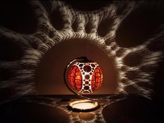 If you're looking for an original table lamp, look no further! Polish artist Przemek, also known as Calabarte, sculpts beautiful patterns on African gourds which later become heads of his exceptional lamps. When you switch on one of his lamps, the light coming trough the cracks of the gourd turns a room into a dreamlike space.