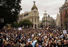 Demonstrators take part in a march to the Spanish Parliament against the austerity measures announced by the Spanish government in Madrid. Spanish People, Arab Spring, Arms Race, Riot Police, Austerity, North Korea, Madrid, Greece, Dolores Park