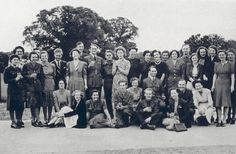 Old black and white photo of people at Bletchley Park