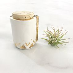 Adorned in real 22k gold luster, this cylindrical fold-over stash jar is the perfect accessory for any lady who is ready to up her smoking wares game. Proudly leave your jar sitting out for all to see, and get ready to rake in the compliments. Ready to ship!   THE BASICS  △ This stash jar is hand crafted in Kansas City using porcelain clay.  △ Glazed in white. 22k gold accents are then painted by hand and the piece is fired for a final time in the kiln.  △ Looking for another color, shape…