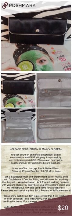 """Jewelry Travel Safe Clutch Like New Jewelry Clutch Black/Silver Satin Like Material. Silver Tone Snap front Closure. Measurements Closed Clutch: 4""""Tall X8.75""""Wide. Opened Inside 2 Zipper Pockets, 2 Snap close Pockets and Earring holder. This clutch/Wallet is a great way to travel and keep your jewelry safe. 15% Discount given when you Bundle 3 or more items. Thank you for browsing my closet. Boutique Bags"""