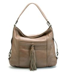 Buttersoft Italian leather, the essence of this beautiful timeless classic. Subtle hardware detail with the additional convenience of front slip and back zip pockets.  Features      Zip top entry     External back zip pocket     Additional front slip pocket with magnetic snap & tassel detail     Versatile shoulder strap included to wear as a Shoulder Bag or Cross Body Bag     Internal leather trimmed zip pocket, phone pocket and key clip     Padded stitch detail handle     He..