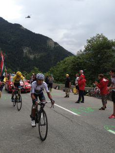 Le Bourg-d'Oisans, summer 2013. Tour de France GC leader and the youth GC leader