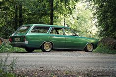 There were 2 Opel Rekord's. One dark green and one white.