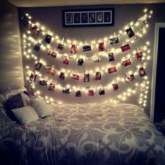The bedspread is so pretty and I love how they strung the lights and clipped pictures on it!!!