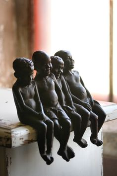 cast iron laughing boys sculpture