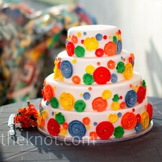 The four-tiered wedding cake covered with colorful marzipan flowers was anything but traditional.
