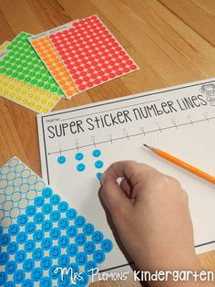 "Build Kindergarten Number Sense with these 20 differentiated centers! With ""Super Sticker Number Lines,"" students practice number order and one to one correspondence in creating their own number lines."