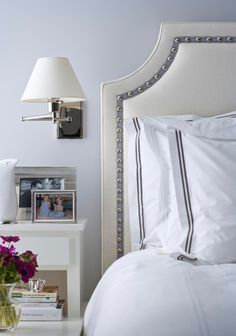 It's all in the details! Nailhead trim on the headboard plays perfectly with bed linens from Restoration Hardware. - Traditional Home ®/ Photo: John Bessler / Design: Christina Murphy