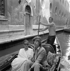 vintage everyday: Early Photos of Celebrities in Venice Mick Jagger in Venice, 1971. Rolling Stone Mick Jagger, wearing a suit, sitting next to Bianca Jagger wearing a white poncho and sunglasses, in a gondola, with the gondolier behind them.