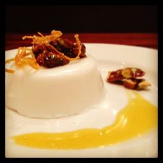 coconut pana cotta with passion fruit coulis and pistachio brittle