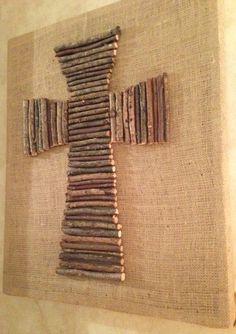Cross made from oak wood limbs on burlap canvas